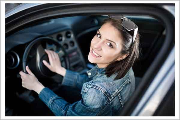 Smiling Woman in Car